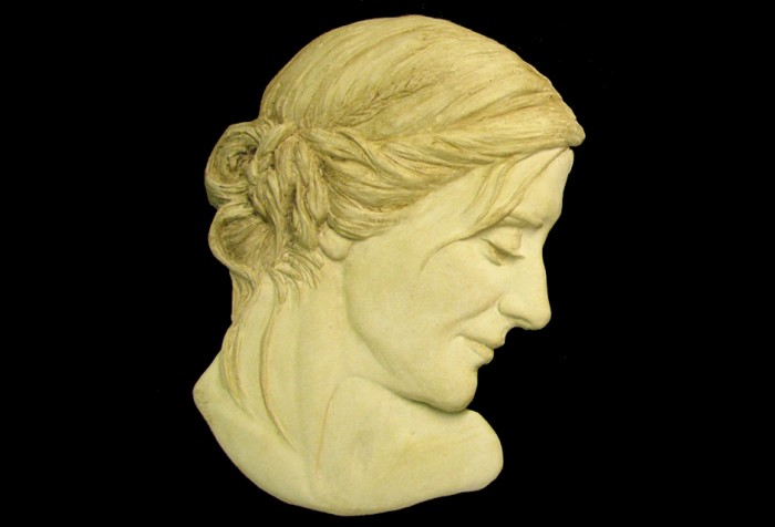 Portrait Sculpture of Nina in relief.