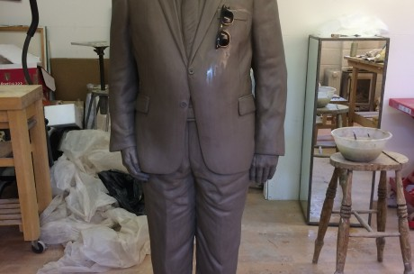 life -size male figure in clay